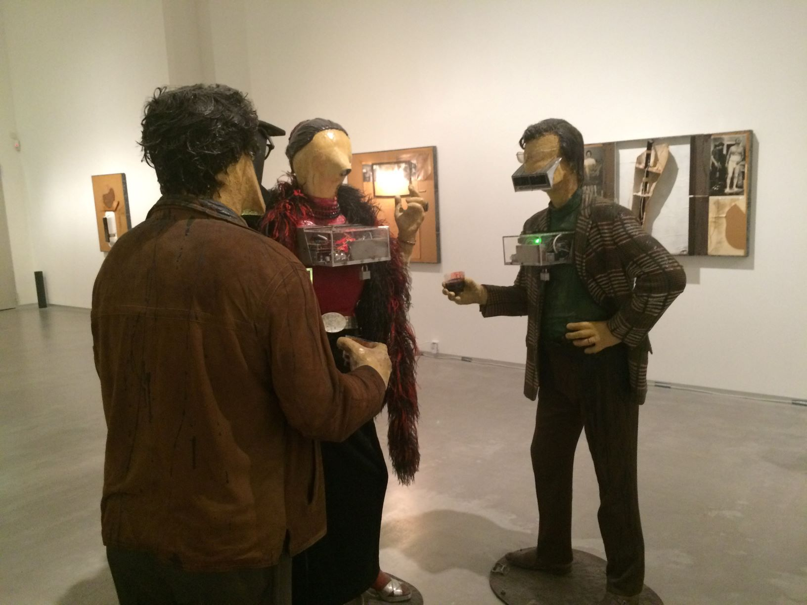 Art installation inside of the Berlinische Galerie. -- Edward and Nancy Reddin Kienholz's 'The Art Show.' This one was a parody of the opening night of an art exhibition, in which the mannequins had tape recorder heads and would play back soundbites on just how impressed or nonplussed they were with the show.
