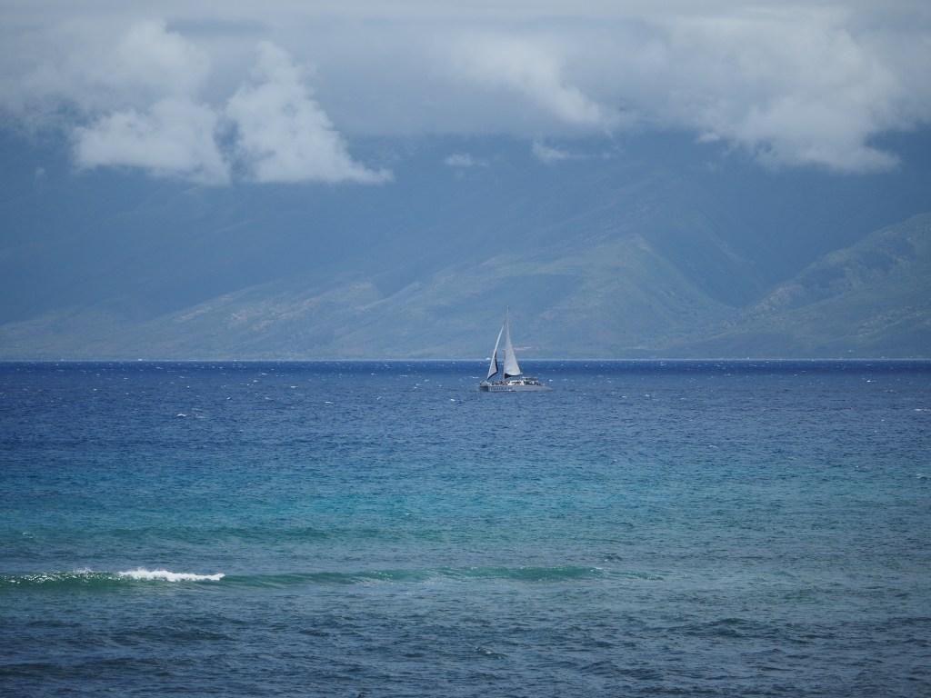 A sailboat out near Molok'ai, shot from a balcony in Kahana