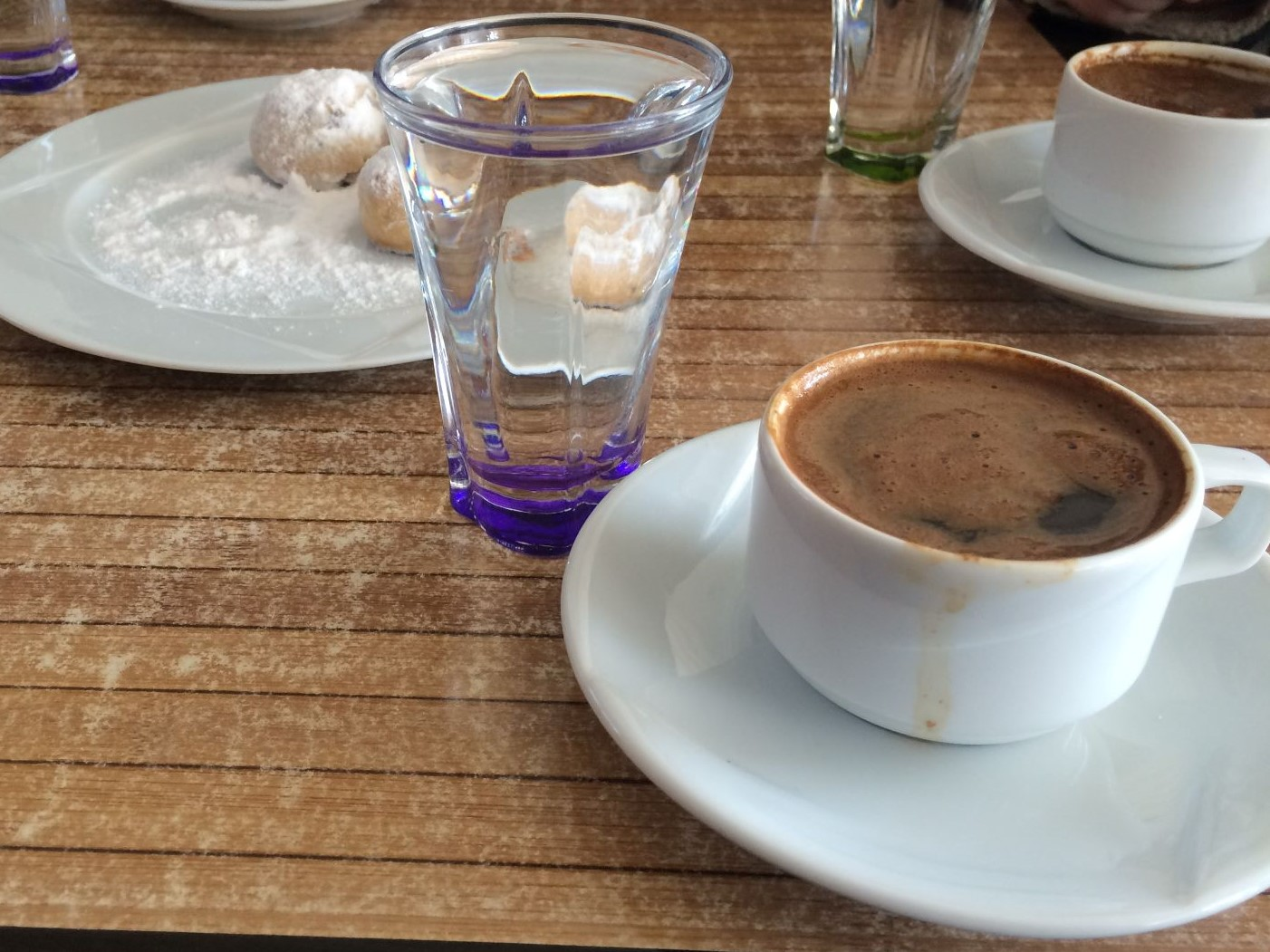 A beautifully presented c coffee alongside Greek pastries, somewhere on Gökçeada. April 2016.