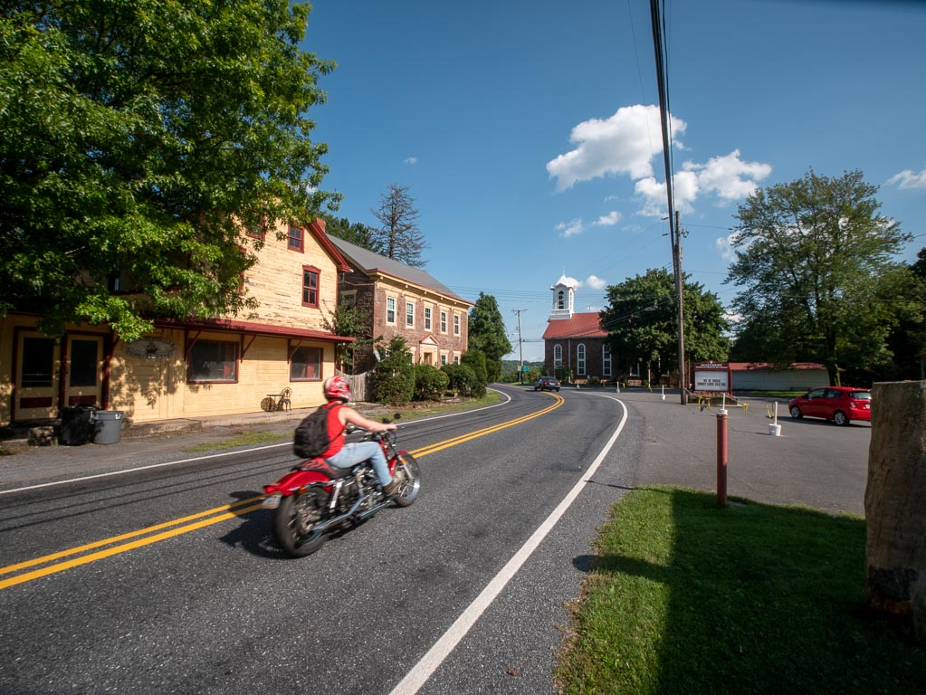 A biker passes through the center of Alleghenyville