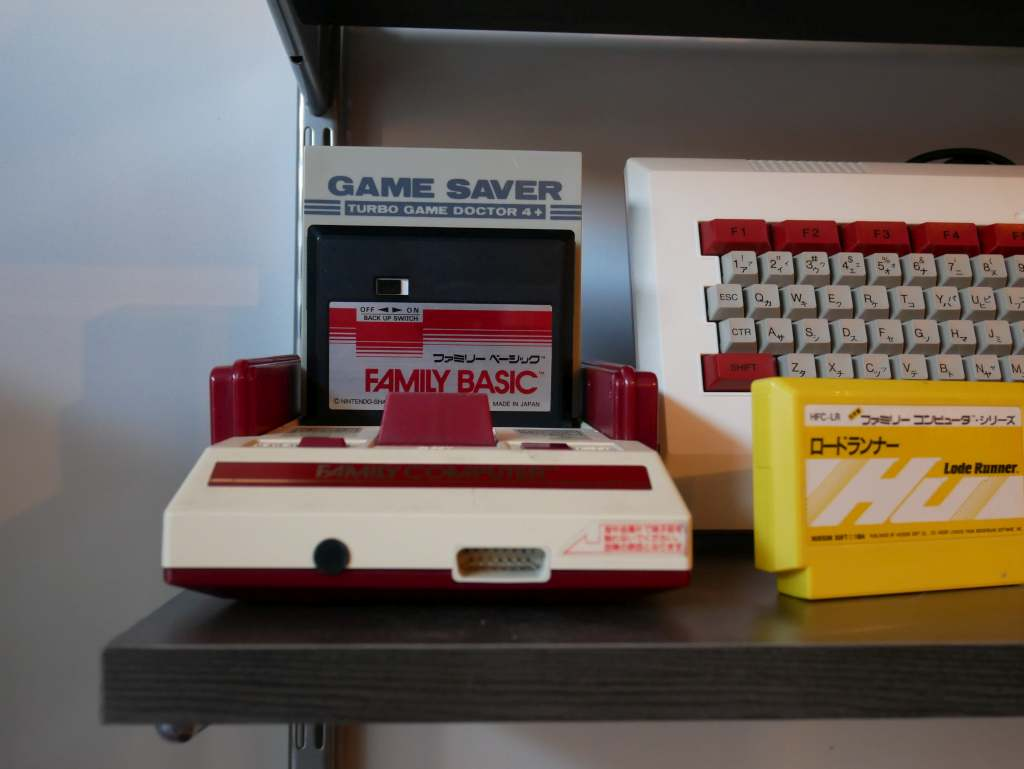 A Nintendo Famicom (1983) with a copy of Family BASIC (1984). It's rather startling how much more svelte this console and its cartridges were compared to the 'bigger is better' American Nintendo Entertainment System.